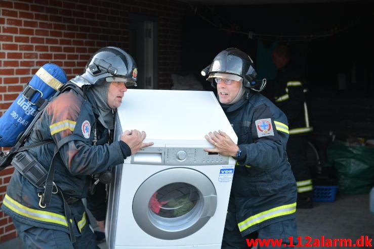 Ild i en vaskemaskine.